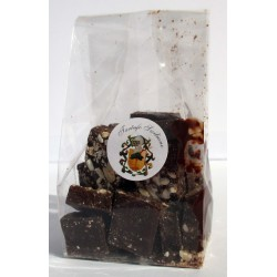 Cubes of black chocolate with white truffle, honey and almonds 100gr